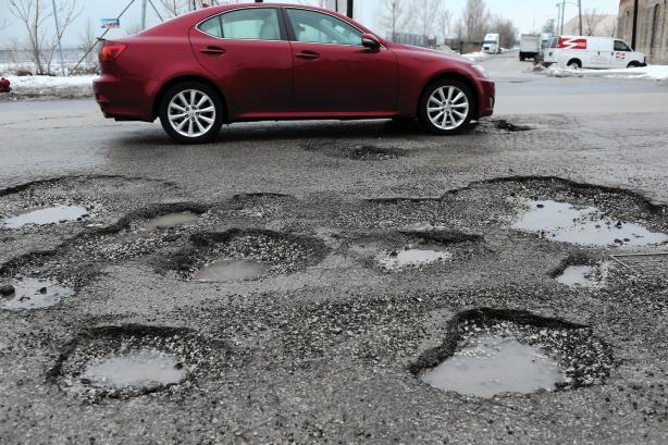 A car and potholes