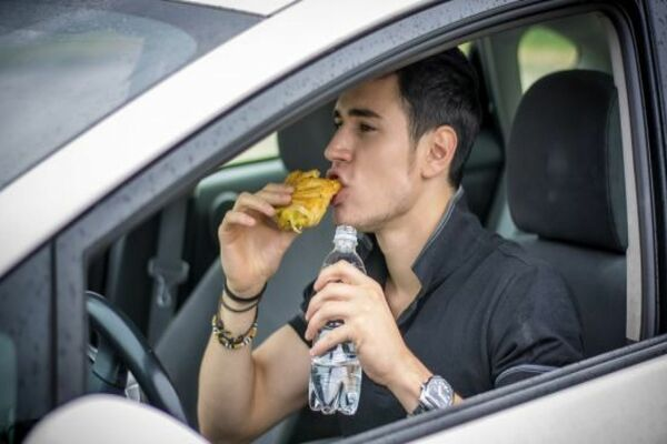 Man eating in the car
