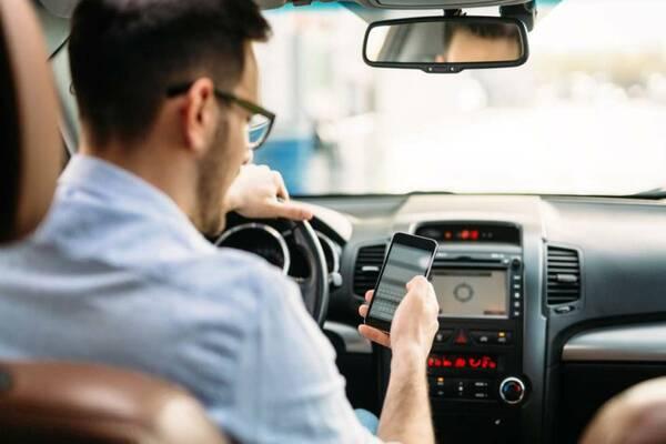 Man using phone in the car
