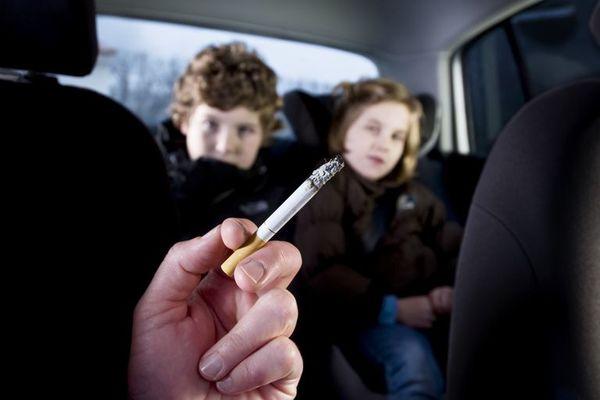 Man using cigarette inside the car