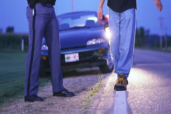 Traffic enforcer conducting a sobriety test