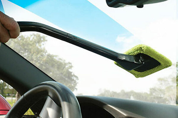 Man cleaning the windscreen