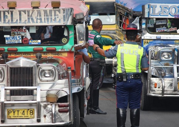 a jeepney gets pulled over